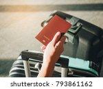 hand holding passport traveler... | Shutterstock . vector #793861162