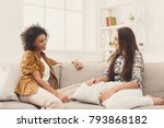 two happy young female friends... | Shutterstock . vector #793868182