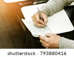 student holding pencil writing... | Shutterstock . vector #793880416
