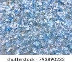 Stock photo  bottle flake pet bottle flake plastic bottle crushed small pieces of cut blue plastic bottles 793890232