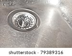 Wet kitchen sink with filter - stock photo