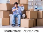 young man moving in to new... | Shutterstock . vector #793914298