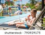 a cute toddler boy drinking a...   Shutterstock . vector #793929175