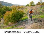 cyclist in orange riding the... | Shutterstock . vector #793932682