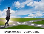young businessman at crossroads ...   Shutterstock . vector #793939582