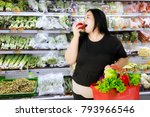 obese woman eating an apple... | Shutterstock . vector #793966546