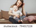 mother holds on hands her...   Shutterstock . vector #794017228
