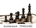 chess and stack of coins in... | Shutterstock . vector #794021482