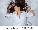 girl sleeps in a white bed at... | Shutterstock . vector #794029582