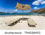empty lounger under sunshade on ... | Shutterstock . vector #794038492