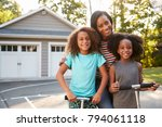 mother with children riding... | Shutterstock . vector #794061118