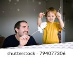 father and son play in the... | Shutterstock . vector #794077306