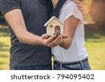 family  holding home model.... | Shutterstock . vector #794095402