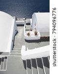 Small photo of Santorini Island, Greece. Traditional white Greek architecture over Caldera, a beautiful landscape overlooking the Aegean Sea.
