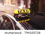 Yellow Taxi Car Roof Sign At...