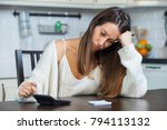 young woman calculating her... | Shutterstock . vector #794113132