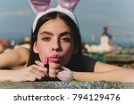 easter woman posing with pink... | Shutterstock . vector #794129476