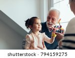 young girl playing with a new... | Shutterstock . vector #794159275