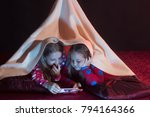 kids in pajamas covered with... | Shutterstock . vector #794164366