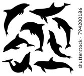 Silhouettes Of Dolphins. Set....
