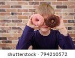 little happy cute boy is posing ... | Shutterstock . vector #794210572