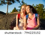 two women hiking on top of the... | Shutterstock . vector #794225152
