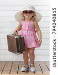 little girl play with suitcases ... | Shutterstock . vector #794240815