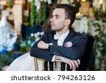 the groom adjusts his jacket ... | Shutterstock . vector #794263126