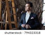 the groom adjusts his jacket ...   Shutterstock . vector #794323318