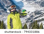 young boy carrying skis | Shutterstock . vector #794331886