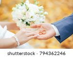 two gold rings in the hand of... | Shutterstock . vector #794362246