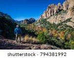 a man is standing near a cliff... | Shutterstock . vector #794381992