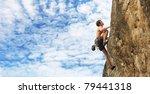 young man climbs on a cliff... | Shutterstock . vector #79441318
