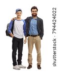 Small photo of Full length portrait of a father and his teenage son isolated on white background