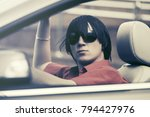 young man in sunglasses driving ... | Shutterstock . vector #794427976
