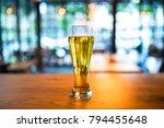 glass of beer on old wooden... | Shutterstock . vector #794455648