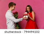 handsome man holds red roses...   Shutterstock . vector #794494102