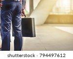 a businessman carrying a... | Shutterstock . vector #794497612