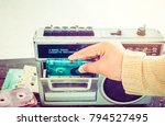 retro lifestyle   woman hand... | Shutterstock . vector #794527495