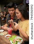 couple taking photos of food... | Shutterstock . vector #794550592