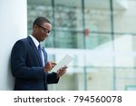 smiling businessman reading... | Shutterstock . vector #794560078