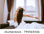 young long haired girl sits in... | Shutterstock . vector #794565436