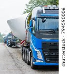 Small photo of Schleswig Holstein, September - April 17, 2017: heavy transport for wind power plant is waiting for approval to continue on parking lot in Hamburg