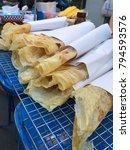 Small photo of Crispy Roti at walking street, Mueang Nan District, Nan, Thailand.