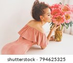 Stock photo lifestyle photo of beautiful young woman with pink peonies bouquet as gift emotions of happiness 794625325