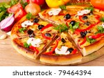 pizza and vegetables on wooden... | Shutterstock . vector #79464394
