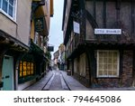 Small photo of Little Shambles, York/England - December 25, 2015: The famous narrow medieval street of The Shambles in Old Town York, Many of the buildings here date back to the fourteenth and fifteenth century.