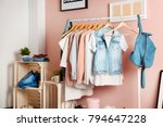 Stock photo collection of clothes hanging on rack in dressing room 794647228
