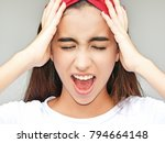 stressed youthful colombian... | Shutterstock . vector #794664148