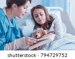 older sister reading a book to... | Shutterstock . vector #794729752